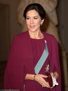 Crown Princess Mary of Denmark stuns in a head-to-toe plum gown for New Year's Reception...