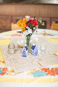 Table decor ideas. Love the vintage sheet music and sweet little homes