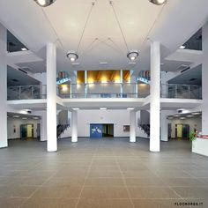 """The new School Center of Mezzolombardo, built in 2011, is an exemplary project in terms of eco-friendly architecture. Not for nothing, one speaks of LEED """"Silver"""" certification in the """"LEED for School"""" category. When choosing the flooring inside the school, the characteristic of Ecotech with its high content of recycled material, certified Ecolabel and Bureau Veritas, has convinced the commission. Architect: Arch. Bortolotti Roberto, Villazzano Italy #Greenwich #iGuzzini"""