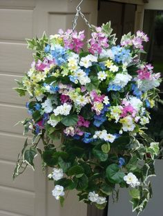Hanging basket with artificial white geranium