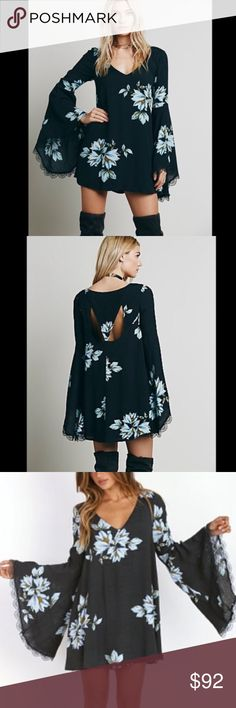 Free People Wanderer Bell Sleeve Dress DESCRIPTION This charming floral Free People mini dress has a mod silhouette with an alluring back cutout. V neckline. The long bell sleeves are trimmed with lace cuffs. Lined. Great condition. Looks like it is sold out everywhere! Free People Dresses