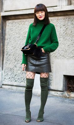 Green sweater, green thigh boots, leather skirt and crossbody bag