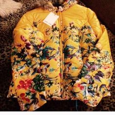 BEAUTIFUL FLORAL NEIMAN MARCUS/ JOHN JENN JACKET Io my listing is for a lovely gold and floral puffer jacket by Neiman Marcus/JON JENN. This jacket has a hood and photo for trim. The jacket zips up in the front and ties at the chin..This jacket has never been worn and it is NWT New with tags NICE! Jon Jenn Jackets & Coats Puffers