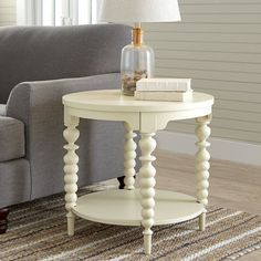 Add a touch of charm to a vibrant seating group with this lovely end table, or top it with a rope-wrapped accent and seashell-filled vase to craft a nautical focal point.