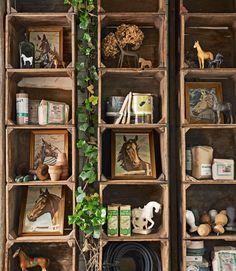 A horse-themed collection of figurines, paint-by-numbers, and more lives in the toolshed. Carloftis built the shadow-box shelving in just 30 minutes, using 18 fruit cartons that he nailed to the wall.   - CountryLiving.com