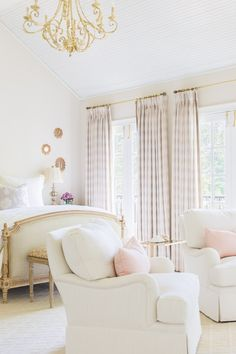 A charming white, gold, and blush bedroom decor!