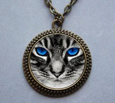 Black cat pendant  wearable artwork by Iimagedeverre on Etsy, $10.00