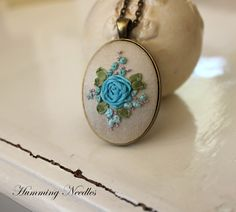 Aqua Rose Bouquet on Ivory - Silk Ribbon Embroidery Pendant Necklace by HummingNeedles on Etsy https://www.etsy.com/listing/201899830/aqua-rose-bouquet-on-ivory-silk-ribbon