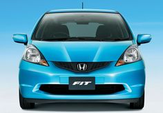 Honda Fit! I need this car it is so cute! Good gas mileage and a bunch of room in the back end Mhm!