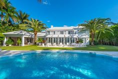 A sparkling pool is just one of the many amenities of this gorgeous Miami estate whose grounds encompass over feet. Open and covered patios ensure there's always outdoor entertaining potential. Beach Mansion, Beach House, Pool Images, Pool Picture, Beautiful Pools, Beautiful Places, Outdoor Retreat, Dream Pools, Dream House Exterior