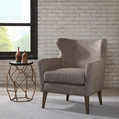 A modernized neutral tweed gives this Scandinavian inspired, modern wing chair its chic appeal. #MadisonParkDreamSpace