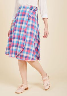 Though this cotton skirt from our ModCloth namesake label offers two distinct looks, the outfits you can create with its versatility are endless! Envision yourself pairing pieces galore with the blue, pink, and white plaid side of this wrap-style midi, or daydream what you can do with its gingham reverse. The options know no bounds!