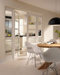 white kitchen and Chair Eames DSR Home Living Room, Living Spaces, Sweet Home, Interior Architecture, Interior Design, Dining Lighting, White Doors, Internal Doors, Kitchen Interior