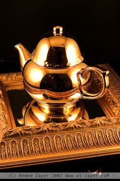 Golden teapot on mirrored tray. May be too over the top for camping -- even with the steampunk twist.