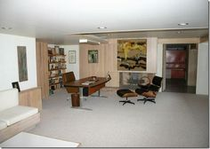 Eames furniture in the basement of a time capsule mid-century home