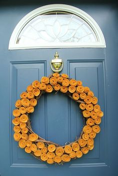 Felt flower fall wreath.  Want this on my door right now!