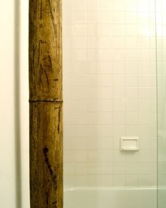 Covering up exposed pipe with bamboo!?  BRILLIANT!