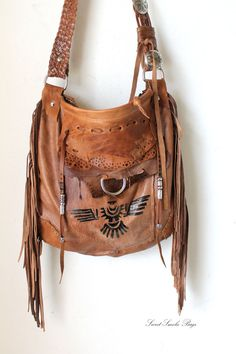https://www.etsy.com/listing/228417388/fringed-lwarm-brown-leather-tribal-eagle?utm_campaign=Share