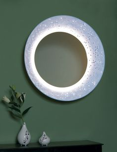 Bodo Sperlein has designed a mirror using not one branded material but two: Corian and Swarovski crystals