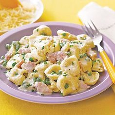 tortellini, ham, peas, and alfredo sauce. but you can pick any sauce