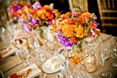 Fall wedding reception at the Ace Conference Center. Deep orange and rich purple flowers accented by bittersweet berries and gold votives.