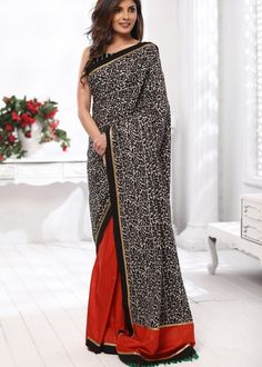 Printed cotton saree with rust colored semi silk pleats