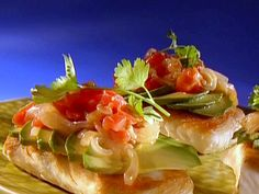 Halibut Veracruz from FoodNetwork.com.  I'm going to have hubby make it tonight.  SOunds very yummy!