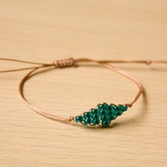 This sweet and simple beaded bracelet use just a few seed beads and some thread and is finished with a sliding knot.