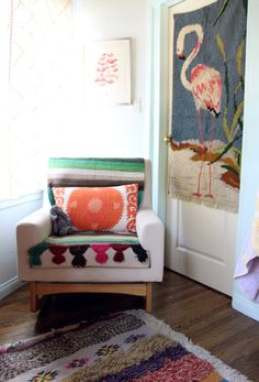 Sleepytime Rocker from Tottini, Flamingo wall-hanging, suzani print pillow--in the l'il Boomba's nursery on D*S