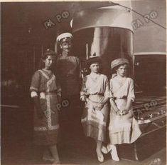Grand Duchesses Maria, Tatiana, and Olga Nikolaevna with an officer, ca. 1911.