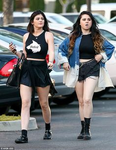 Making her mark: Kylie Jenner and her friend uses her dress to set herself apart
