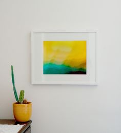 Cameras for Healing participant Joseph's abstract photo in yellow brightens up the room!