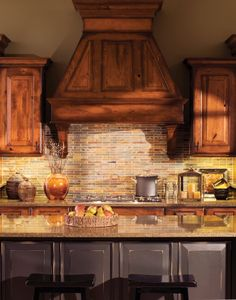 Rustic Kitchen - Dura Supreme Cabinetry Platform Hood can be designed with corbels that don't intrude on the countertop space next to the cooktop.