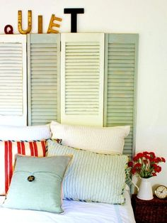 College Girl Taking On the World blog on college decorating! Shutters headboard!!