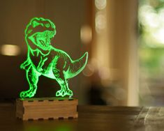 what a cute idea to brighten up a dark room! DInosaur Night Light T-Rex desk lamp Desk accessory USB by lampUp Illusion 3d, Usb Lamp, Mood Lamps, Tyrannosaurus Rex, Geek Gifts, Bf Gifts, Desk Accessories, Cnc Router, T Rex