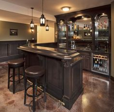 I want to put a wet bar in down stairs! I love the style of this one...I will put a sink and a fridge and a microwave too!
