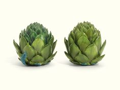 A PAIR OF FAIENCE ARTICHOKE TUREENS AND COVERS, PROBABLY STRASBOURG, PAUL HANNONG PERIOD, MID 18TH CENTURY naturalistically modelled with leaves painted in shades of green Quantity: 4 10.25cm., 4in. high Estimate   6,554 - 9,830USD LOT SOLD.  (14,336 USD)
