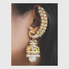 Beautiful earrings which acts as cuff too with kundan in the shape of peacock! Perfect for your traditions outfits by House of Shikha! Ear Cuff Jewelry, Indian Jewelry Earrings, Fancy Jewellery, Jewelry Design Earrings, Gold Earrings Designs, Antique Earrings, Trendy Jewelry, Fashion Earrings, Fashion Jewelry