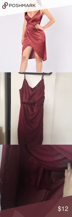 Burgundy dress -- Read description Beautiful burgundy dress with v neckline, front slit, hidden back zipper and adjustable straps! It's brand new but came with a defect in the lining (see photos). You can't see it with it on and it is SO fixable with basic sewing. Fashion Nova Dresses High Low
