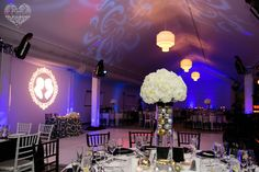Love the combination of blue uplights and pattern projection! #blue #wedding #uplighting