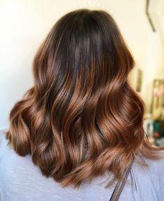 wavy auburn balayage hair