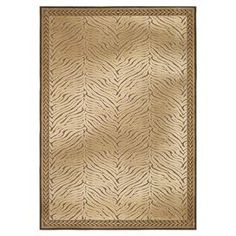 Art silk rug with a zebra-print motif.   Product: RugConstruction Material: Art silkColor: BrownFeatures:  Made in BelgiumPower-loomed Note: Please be aware that actual colors may vary from those shown on your screen. Accent rugs may also not show the entire pattern that the corresponding area rugs have.Cleaning and Care: Professional cleaning recommended