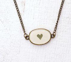 Pressed Leaf Necklace - preserved clover leaf in bronze pendant - handmade resin jewelry. $25.00, via Etsy.