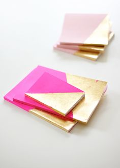 DIY gold leaf journals... you could also do this to a piece of wood or something and hang it on a wall and that would be cute too