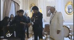 Video of the event from the Vatican's YouTube page does the moment more justice than a simple picture ever could. | Bolivia's President Just Gave The Pope A Hammer And Sickle Crucifix - BuzzFeed News