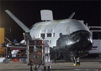 The Air Force's first unmanned re-entry spacecraft, X-37B Orbital Test Vehicle, landed at 1:16 a.m. Dec. 3, 2010, at Vandenberg Air Force Base, Calif. The X-37B conducted on-orbit experiments for more than 220 days during its maiden voyage. (U.S. Air Force photo/Michael Stonecypher)