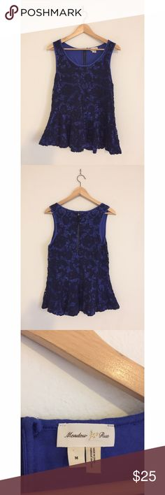 meadow rue anthropologie peplum crotchet tank top this tank top is from anthropologie (meadow rue brand) and is a bright royal blue color with dark blue crotchet overlay.  it is a slightly relaxed fit, size M, and features a zipper on the back.  it flares at the waist. Anthropologie Tops Tank Tops