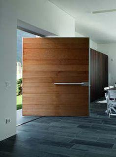 Bold and simple pivoting front doors. Modern Entrance, Modern Door, Entrance Doors, Front Doors, Door Design, Exterior Design, Interior And Exterior, House Design, Pivot Doors