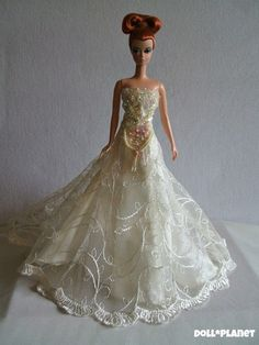 Iridescent hand-beaded and sequined wedding gown. Fits Silkstone Barbie and similar sized fashion dolls. On eBay: DOLL*PLANET  ---------SOLD