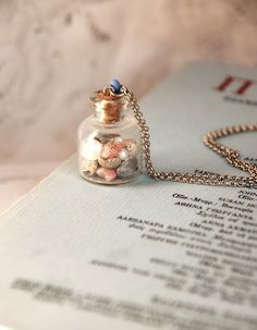 tiny shells in a tiny bottle necklace...